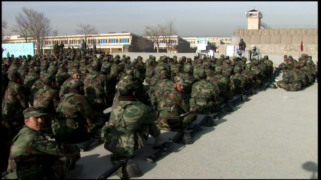 march 9, 2009 afghan national army recruits crouching in formation as other soldiers walk past / afghanistan - afghan national army stock videos & royalty-free footage