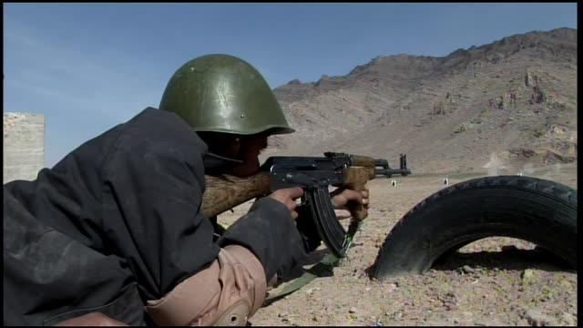march 9, 2009 afghan national army recruits crouching in formation, waiting their turn on the rifle range / afghanistan - afghan national army stock videos & royalty-free footage