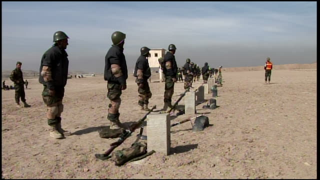 march 9 2009 zi afghan national army recruits firing on the rifle range / afghanistan - afghan national army stock videos & royalty-free footage