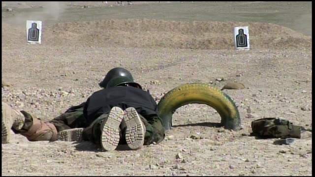 march 9 2009 ts afghan national army recruits in infantry assault training advancing at a run then falling to a prone position / afghanistan - afghan national army stock videos & royalty-free footage