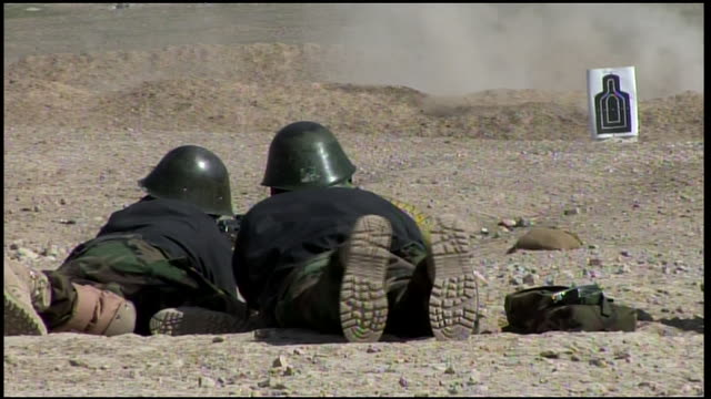 march 9 2009 ha afghan national army recruits in training on the firing range prone position / afghanistan - afghan national army stock videos & royalty-free footage