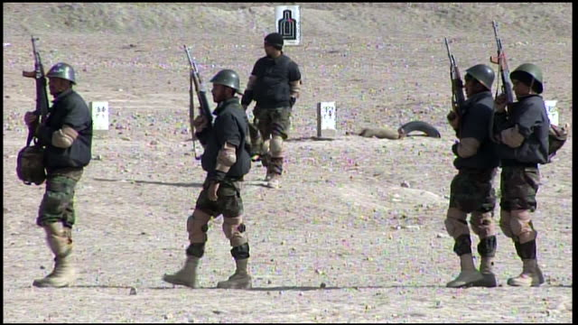 march 9, 2009 afghan national army recruits receiving loaded magazines for target practice on the rifle range / afghanistan - afghan national army stock videos & royalty-free footage