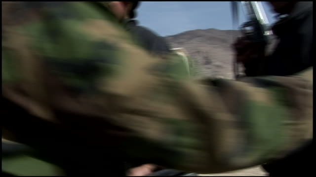 march 9, 2009 afghan national army recruits, rifles in hand, awaiting their turn on the rifle range / afghanistan - afghan national army stock videos & royalty-free footage