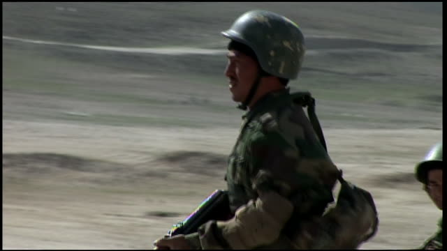 march 9, 2009 afghan national army recruits running in line across rocky terrain / afghanistan - afghan national army stock videos & royalty-free footage
