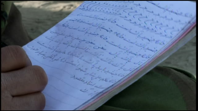 march 9 2009 ha afghan national army recruits writing notes during instruction at training camp / afghanistan - afghan national army stock videos & royalty-free footage