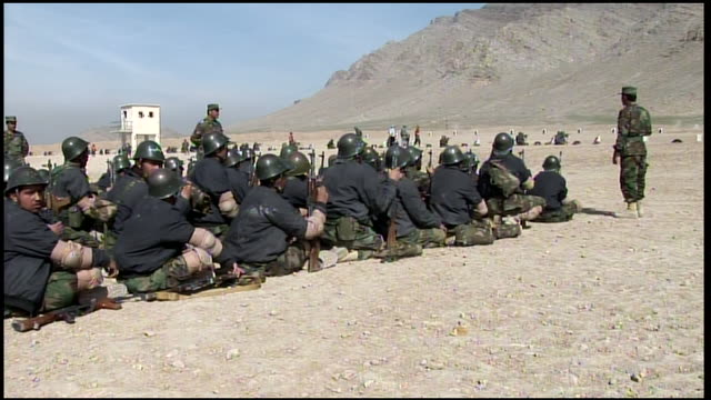 march 9 2009 ms afghan national army sergeant instructing trainees on the rifle range / afghanistan - afghan national army stock videos & royalty-free footage
