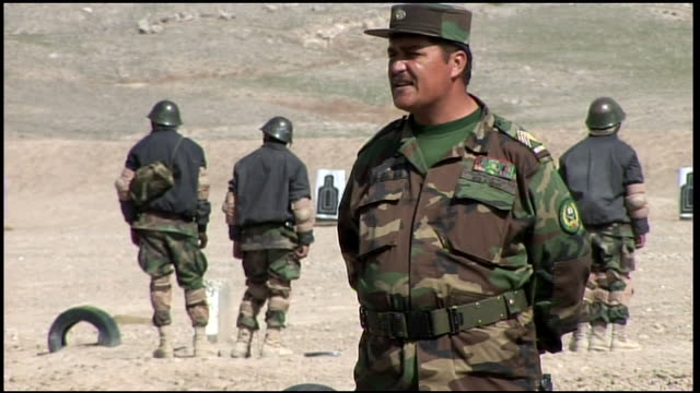 march 9 2009 td afghan national army sergeant issuing magazines of ammunition to trainees on the rifle range / afghanistan - afghan national army stock videos & royalty-free footage