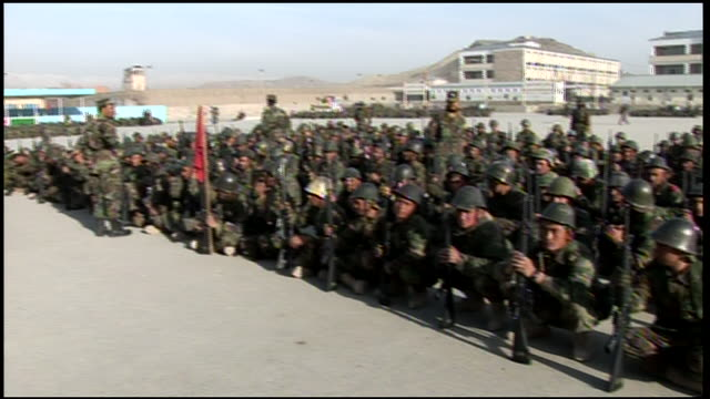 march 9, 2009 montage afghan national army recruits crouching in formation at training camp / afghanistan - afghan national army stock videos & royalty-free footage
