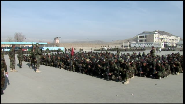 march 9, 2009 montage afghan national army recruits crouching in formation at training camp, receiving weapons instruction / afghanistan - afghan national army stock videos & royalty-free footage