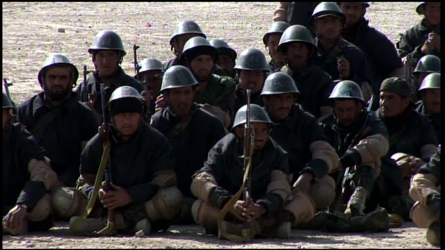 march 9 2009 montage afghan national army recruits crouching in formation waiting their turn on the rifle range / afghanistan - afghan national army stock videos & royalty-free footage