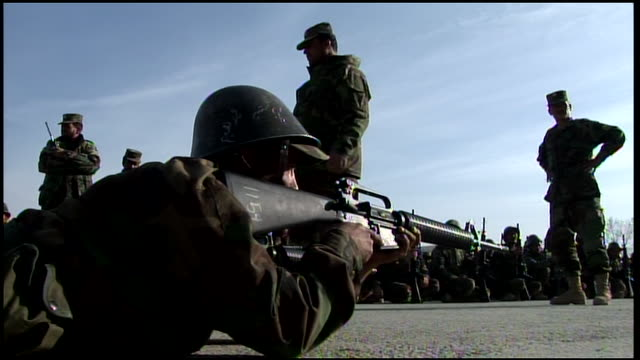 march 9, 2009 montage afghan national army recruits receiving weapons instruction and crouching in formation awaiting their turn / afghanistan - afghan national army stock videos & royalty-free footage