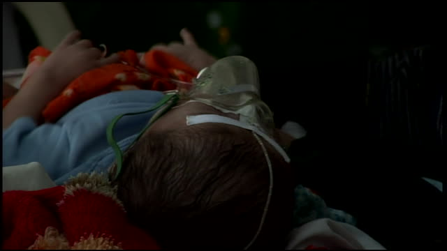 march 9, 2009 montage babies breathing from oxygen masks at hospital / kandahar, afghanistan - babies only stock videos & royalty-free footage