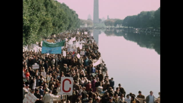 march against the vietnam war. as many as 100,000 us anti-vietnam war protesters stage massive demonstration in washington dc, near the washington... - hd format stock videos & royalty-free footage