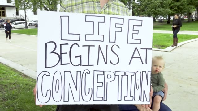 vídeos de stock, filmes e b-roll de march for life ny pro-life rally at the new york state capitol, located in albany, the capital city of the u.s. state of new york. pro life advocates... - decretar