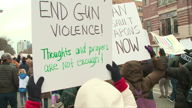 wgn 'march for our lives' participants march chant hold signs in chicago on march 24 2018 - gun crime stock videos & royalty-free footage