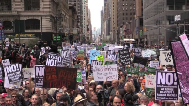 stockvideo's en b-roll-footage met 35000 march from bryant park to trump tower to protest donald trump demanding he release his tax returns - tax