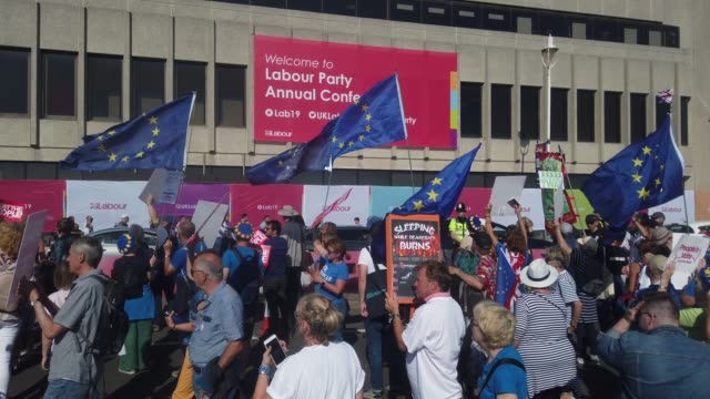 "march in support of a ""people's vote"" on brexit passes the brighton centre, the venue for this years labour party conference, on september 21, 2019... - labour party stock videos & royalty-free footage"