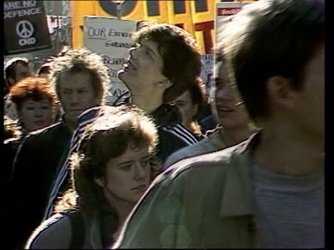 London V Mass of CND marchers over Waterloo Bridge and along the Embankment PAN RL AIR V Mass marchers over Westminster Bridge MS Marchers and...