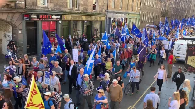 marchers proceed down the royal mile towards the scottish parliament in edinburgh during a pro-remain demonstration. - edinburgh scotland stock videos & royalty-free footage