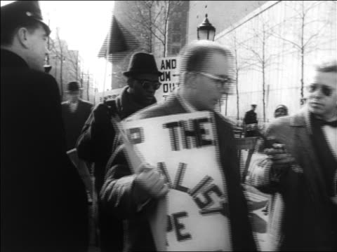 b/w 1960 marchers with signs protesting un intervention in congo / nyc / newsreel - united nations stock videos & royalty-free footage
