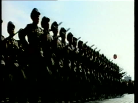 Marching army parade in unison before Kim Jong Il North Korea 11 Mar 2003