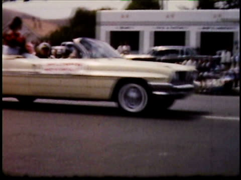 / marching band car carrying a waving Grand Marshal Jayne Mansfield marching boy scouts floats