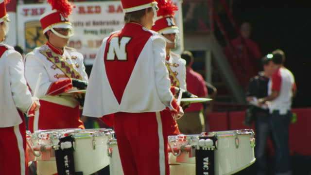 marching band drum percussion section marches and performs during half time at a football game. - marching band stock videos & royalty-free footage