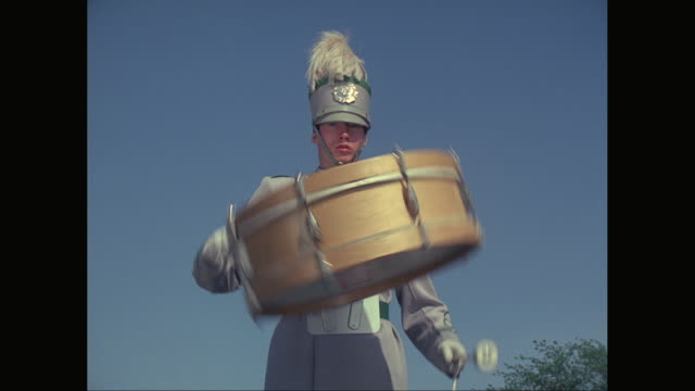 stockvideo's en b-roll-footage met ms marching band drummer wearing spinning drum / united states - drum