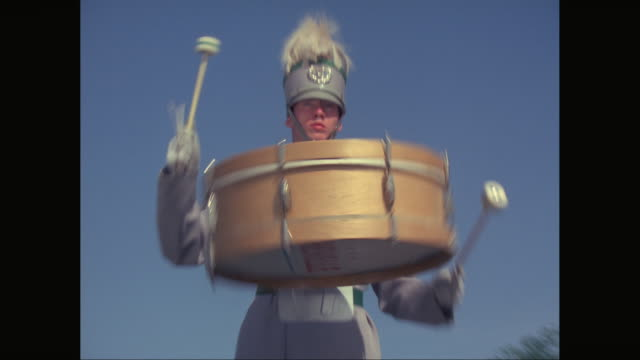 ms zi marching band drummer wearing spinning drum / united states - marching band stock videos and b-roll footage