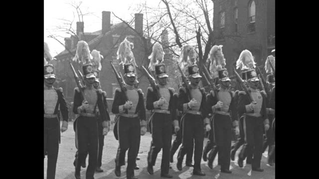 marching band in parade moving down street in old town section of alexandria / president herbert hoover and others seen through big open window of... - george washington stock-videos und b-roll-filmmaterial