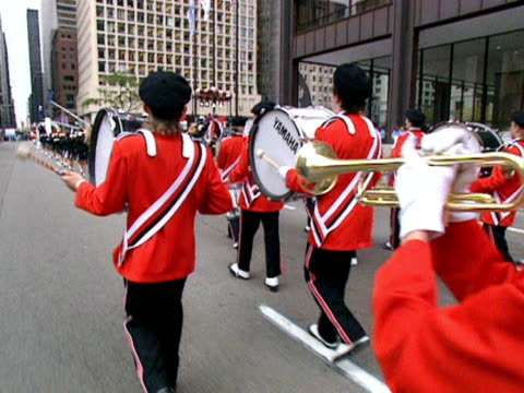 a marching band moves along a street in chicago during a columbus day parade. 1991 - marching band stock videos & royalty-free footage