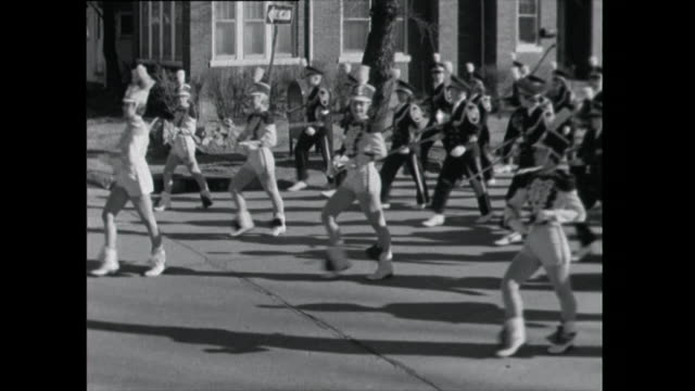 marching band parades through streets - 1961 stock videos & royalty-free footage