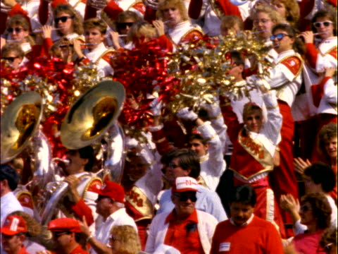 marching band performing in bleachers - cheerleader stock videos & royalty-free footage
