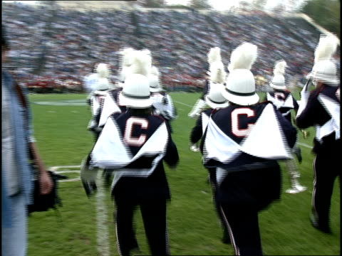 marching band running onto football field - marching band stock videos & royalty-free footage