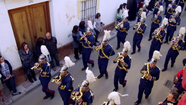MS POV Marching band walking through streets / Archdona, Andalusia, Spain