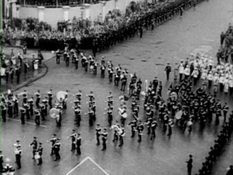 Marching bands and military regiments march in formation through London during the Coronation procession 02 June 1953