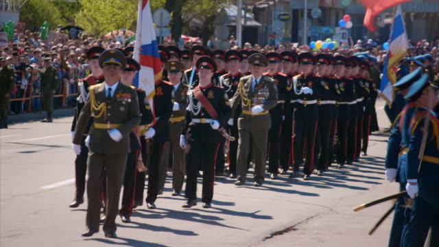 marching bands parade through irkutsk on wwii victory day, russia [partial sound]. - paraden stock-videos und b-roll-filmmaterial