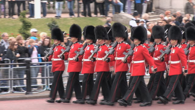 ms ts marching grenadiers at buckingham palace audio / london, united kingdom - marching stock videos and b-roll footage
