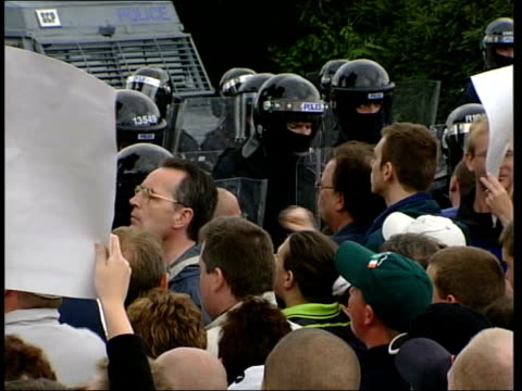 violence itn ireland belfast ext gv security gates opened to allow orange marchers into nationalist area gv orange march towards gvs crowds of... - northern ireland stock videos & royalty-free footage