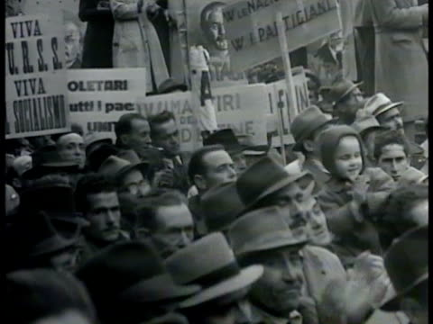 stockvideo's en b-roll-footage met men marching walking in street parade crowd some holding procommunist signs vs soldiers men marching in street ws partisans marching in street w/... - 1948