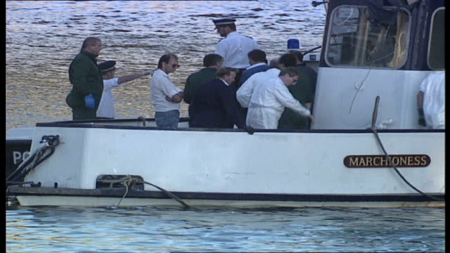 aftermath / aerials england london river thames pleasure cruiser 'marchioness' having been lifted out of the water police and experts on board water... - marchioness stock videos and b-roll footage