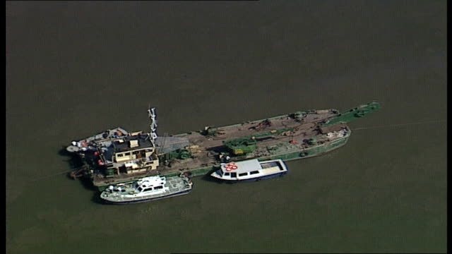 aftermath / aerials england london river thames dredger 'bowbelle' moored salvage vessel in middle of river between bridges - marchioness stock videos and b-roll footage