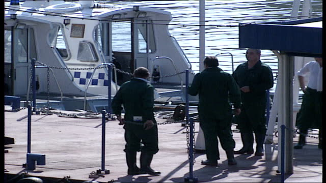 aftermath / aerials england london river thames police launch speeds away police in overalls and wellington boots on pier group onto launch and away... - marchioness stock videos and b-roll footage
