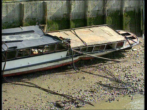 inquest to be reopened cr997 / 2081989 marchioness lying on sandbank ditto ditto name plate marchioness on side of boat pull out to half submerged... - lying on side stock videos & royalty-free footage