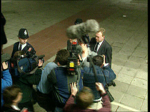 inquest verdict tx 641995 douglas henderson along as enters inquest pan as pushes past reporters old bailey able seaman terence blaney out of court... - marchioness stock videos and b-roll footage