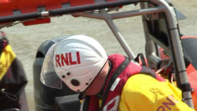 river safety warning on 30th anniversary england london gravesend ext rnli lifeboat pulling into lifeboat station rnli lifeboat crew on lifeboat... - dinghy stock videos & royalty-free footage