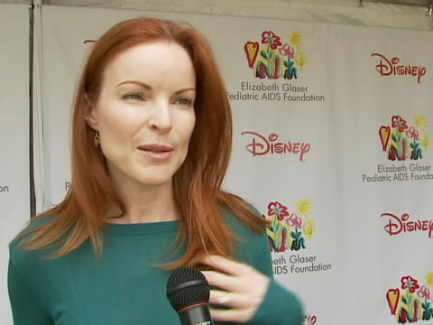 marcia cross on being at the event on how and why she got involved with and supports the foundation what makes the time for heroes carnival special... - elizabeth glaser pediatric aids foundation stock videos & royalty-free footage