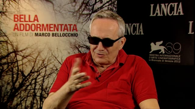 marco bellocchio on winning the 'lifetime achievement award', his hopes for the film at bella addormentata interviews: 69th venice films festival on... - 生涯功労賞点の映像素材/bロール