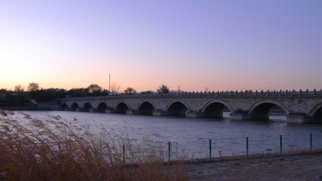 ws marco polo bridge (lugou bridge) at sunset, beijing, china - hai river stock videos & royalty-free footage