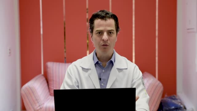 """marcos lucon an urologist doctor during an interview in which he talks about online care the project """"donate a consultation"""" and how the doutor... - doutor stock videos & royalty-free footage"""